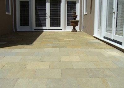 Natural Stone Patio Cleaning-in-Progress by Alex Stone and Tile Services.