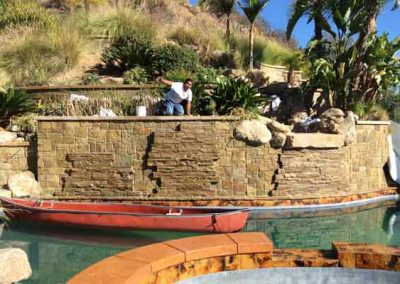 Pool Stone Wall Cleaned and Restored by Alex Stone and Tile Services