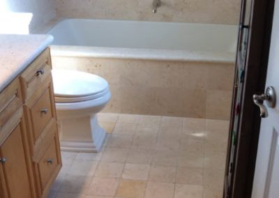 Bathroom Stone Tile Floor Tub Wall Cleaned by Alex Stone and Tile Services